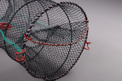 Harvest gear of Eel cylindrical cage. On grey background Royalty Free Stock Photo