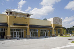 Harvest gold strip mall. Harvest gold colored commercial strip mall with biege tile accents Stock Photography