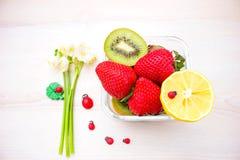 Harvest juicy fruit and berries. lemon, strawberry, kiwi Stock Photography