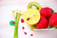 Harvest juicy fruit and berries. lemon, strawberry, kiwi Royalty Free Stock Image