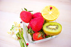 Harvest juicy fruit and berries. lemon, strawberry, kiwi Stock Image