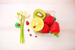 Harvest juicy fruit and berries. lemon, strawberry, kiwi Stock Photos