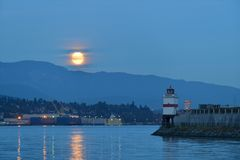 Harvest Moon and brockton point Lighthouse Stock Image