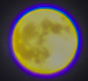 HARVEST MOON. Caught this amazing photo of the full moon with the blue around it Stock Images