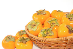 Harvest of persimmon fruit Royalty Free Stock Images