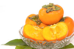 Harvest of persimmon fruit Stock Image