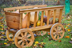 Harvest pumpkins in a wooden cart Royalty Free Stock Photos