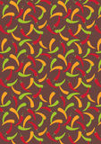 Harvest - Red green and orange hot paper chilli background Royalty Free Stock Images