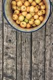 Apples in a bucket on a wooden floor 2. Harvest of ripe apples in an iron bucket on a wooden floor. View from above Royalty Free Stock Images
