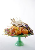 Harvest Still life with pumpkins 1. Pumpkins, indian corn and fall leaves on cake pedestal royalty free stock photo