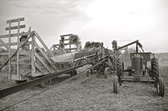 Harvest with a threshing machine Royalty Free Stock Image
