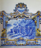 Harvest tiles in Pinhao train station. Wine county of Pinhao is depicted in tiles covering the train station building Stock Photos