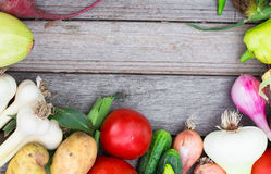 Harvest time. A basket of vegetables on a wooden table. Assorted colorful vegetables and herbs on the old wooden background , harvest time Royalty Free Stock Photos