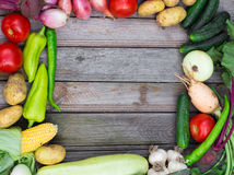Harvest time. A basket of vegetables on a wooden table. Assorted colorful vegetables and herbs on the old wooden background , harvest time Royalty Free Stock Image