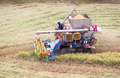 Harvest tractor. Working at paddy field, Thailand Royalty Free Stock Photo