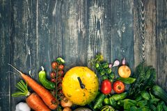 Harvest vegetable on old wooden board royalty free stock photos