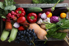 Harvest of veggies in wood box top view. Autumn food Royalty Free Stock Photography