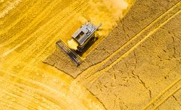 Harvest of wheat field. Aerial view to combine harvester. stock images