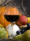 Harvest Wine 2. A glass of red wine with the autumn fruits royalty free stock photos
