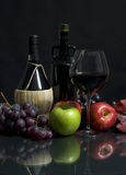 Harvest Wine. Two fine bottles of wine from Chianti, along with autumn fruits Stock Photos