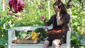 Harvest. A woman with apples and vegetables stock footage