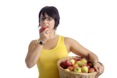 Harvest:young woman with basket full of apples Royalty Free Stock Photo