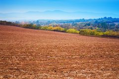 Harvested agricultural field on the hill bank. Harvested agricultural field on the hill Stock Photography