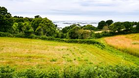 Harvested field on Atlantic coast in Brittany. Travel to France - harvested field on Launay bay of Atlantic coast in Ploubazlanec commune of Paimpol region in Royalty Free Stock Photo