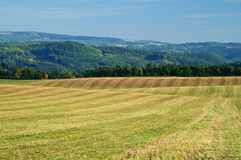 Harvested fields, rolling terrain Stock Photography