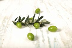 Harvested fresh olives with young olive twig on wooden backgroun. D, Overhead view with space for text Stock Photos