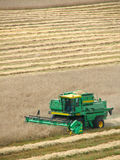 Harvester. Green combine harvester on a field stock photography