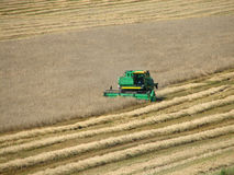 Harvester. Green combine harvester on a field royalty free stock photo