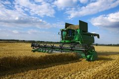 Harvester on agriculture field. During harvest time Stock Image