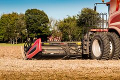 Harvester combine during autumn harvest royalty free stock photography