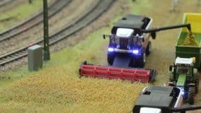Harvester Combine harvest near railroad stock video