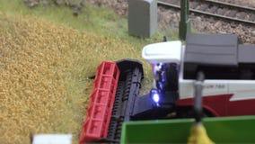 Harvester Combine harvest near railroad stock footage