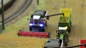 Harvester Combine harvest near railroad stock video footage