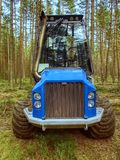 Harvester truck work in young pine forest. Skilful three axes harvester. stock photo