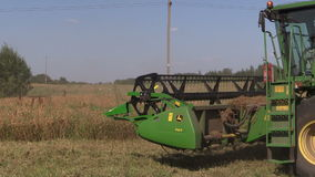 Harvester machine trash pease plants in agricultural field stock video footage
