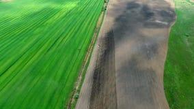 Harvester plowing field in spring stock video