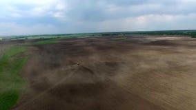 Harvester plowing field in spring stock video footage