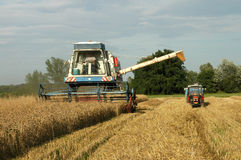Harvester and tractor Royalty Free Stock Image