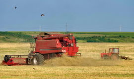 Autumn landscape. Harvester and tractor on the field Stock Photo