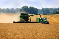 Harvester unloading Stock Photography