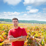 Harvester winemaker farmer proud of his vineyard. In autumn golden red leaves at Mediterranean stock image