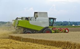 Harvester at work Stock Photo