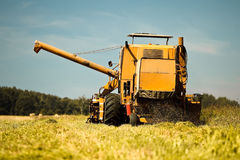 Harvester working Stock Images