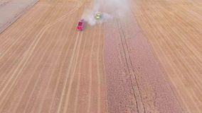 Harvester working in the fields. Top down view stock video footage