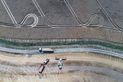 Harvester working on the wheat field. Aerial view on the harvester working on the wheat field Royalty Free Stock Image