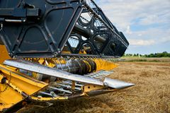 Harvester working on wheat field Stock Photography